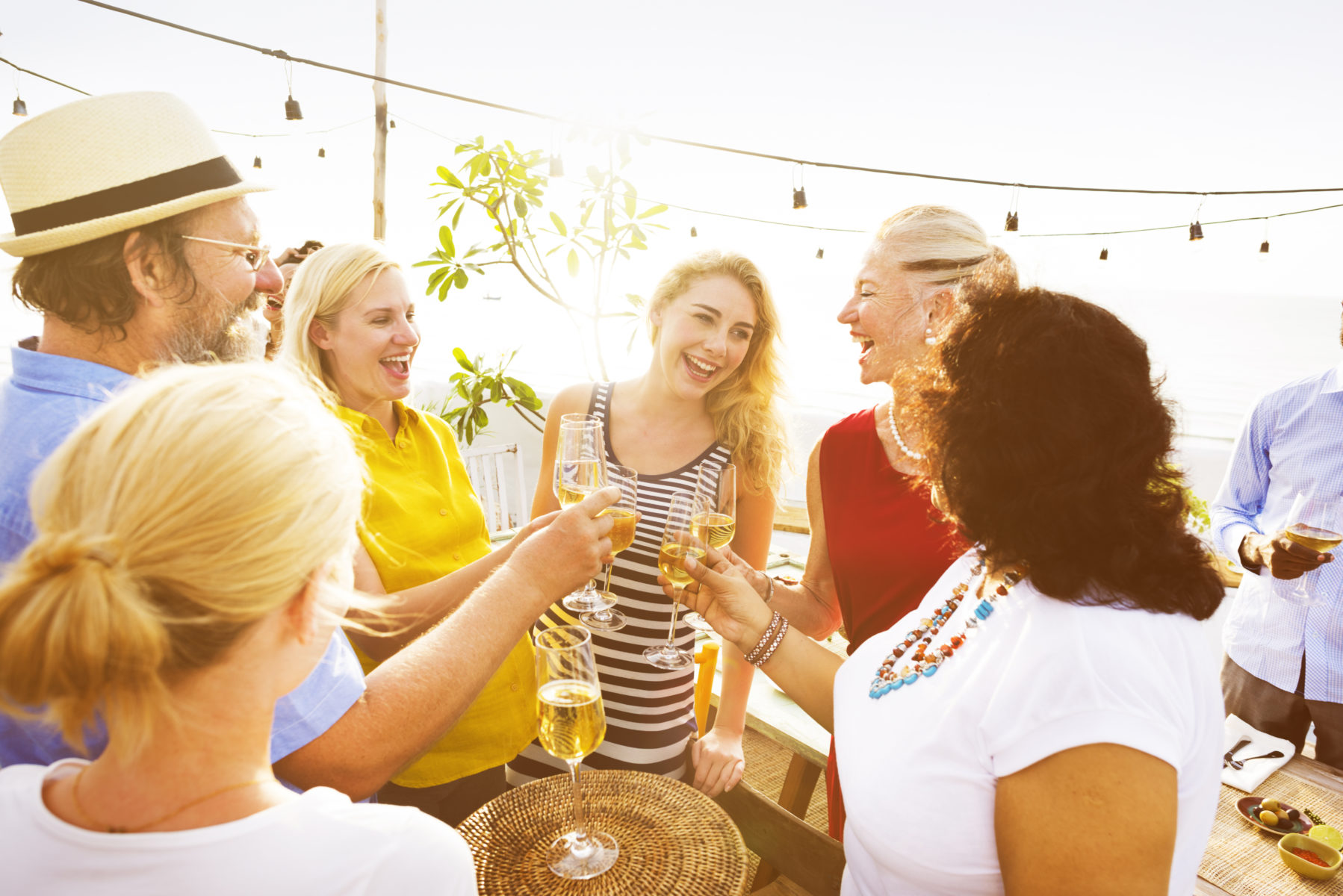 Group of friends enjoying a toast at an outdoor wine festival