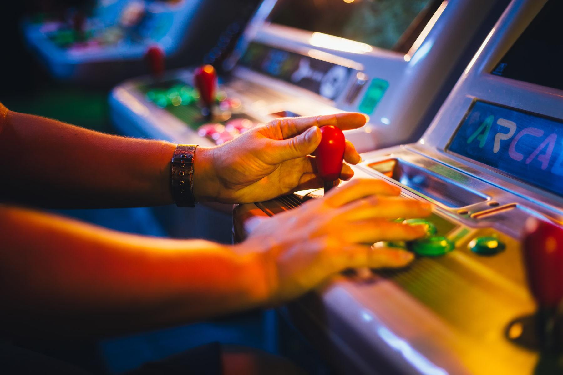 Man playing arcade games