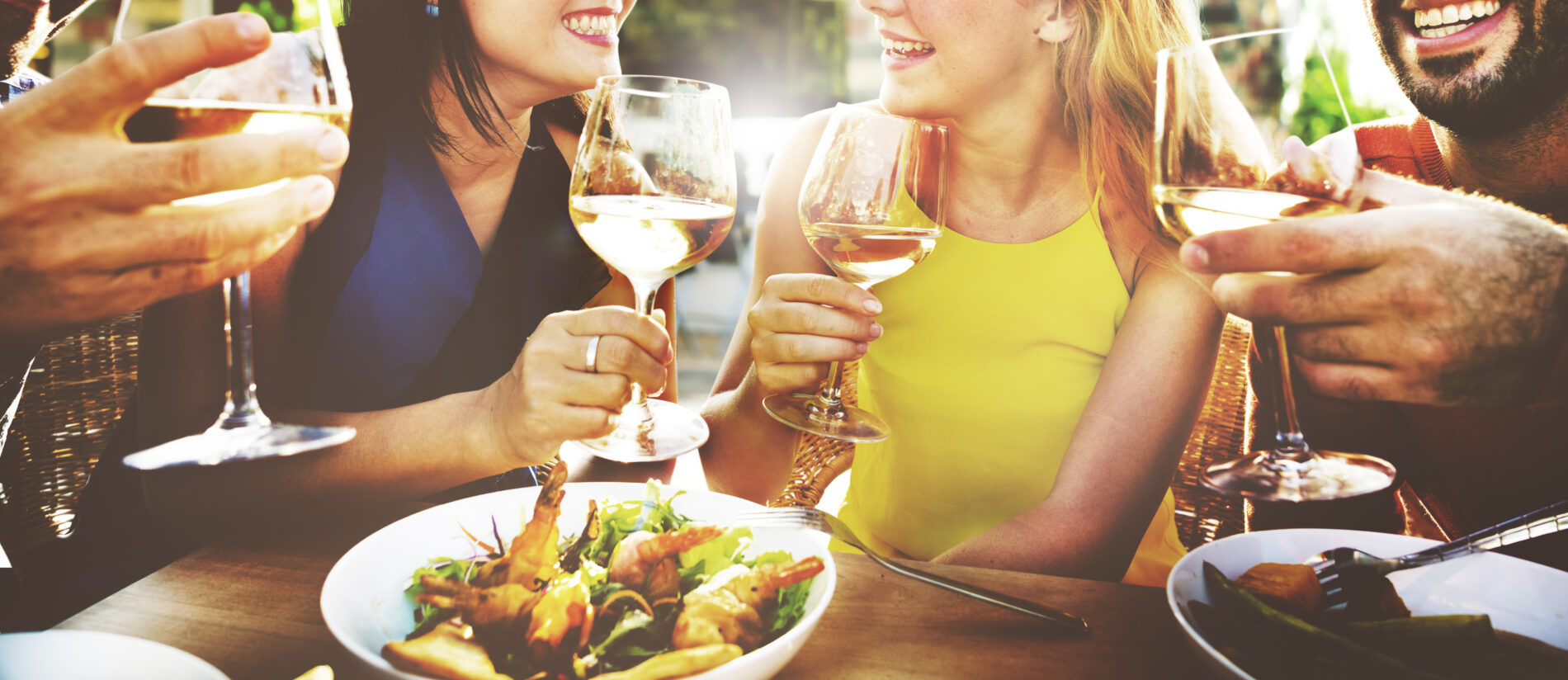 Friends outdoor dining in Marbella, Spain